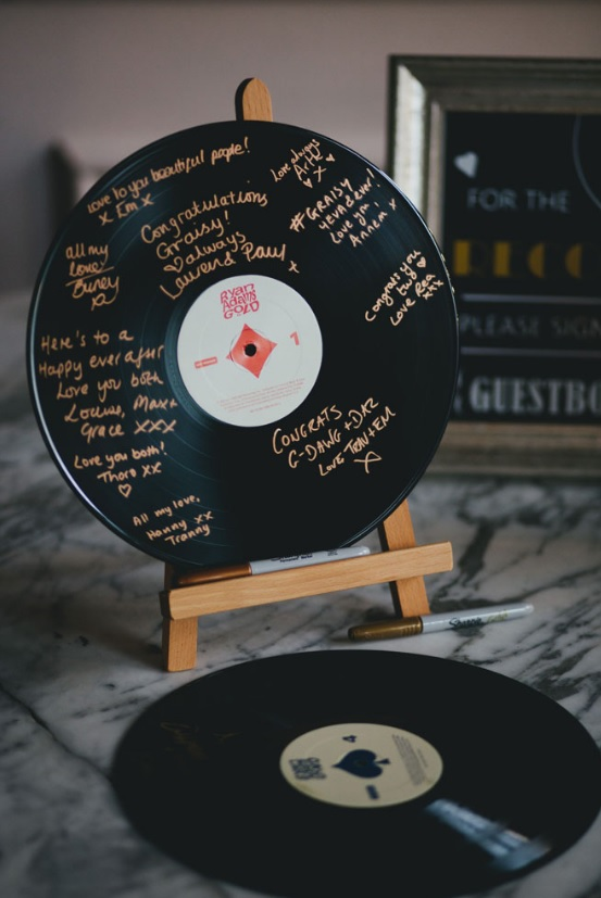 Vinyl was used as a guest book, it's a cool idea for those who want something really special