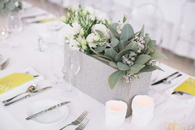 concrete and greenery wedding centerpiece for a clean modern feel