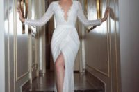 08 heavily beaded wedding dress with a plunging neckline and long sleeves