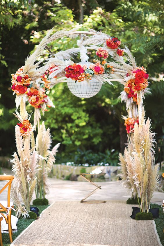 pampas grass arch with bold flowers looks stunning