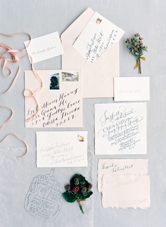 pastel wedding stationery with dark calligraphy