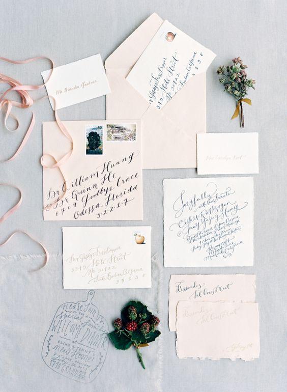 pastel wedding stationery with dark calligraphy