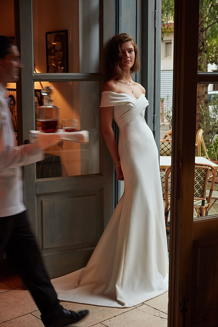 Blake gown has an off-the-shoulder sweetheart neckline, a criss-crossed bodice and sweeping train make it unforgettable