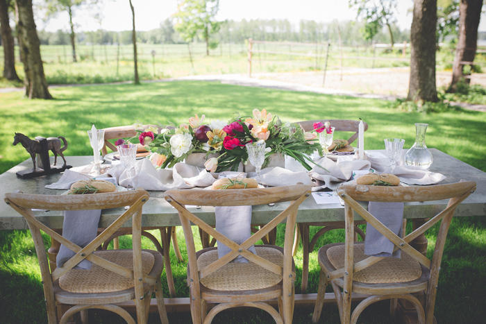 Simple, natural tablescape outdoors with bold florals