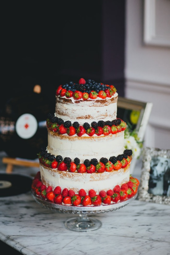 The cake was a semi naked one topped with fresh berries, such a delicious choice