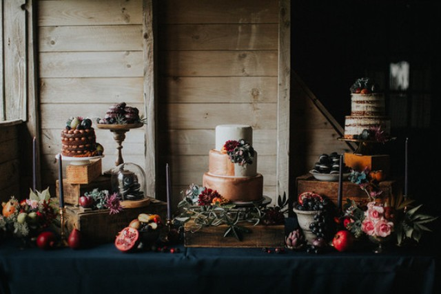 The dessert table was decorated in decadent style, in moody colors and with lots of berries
