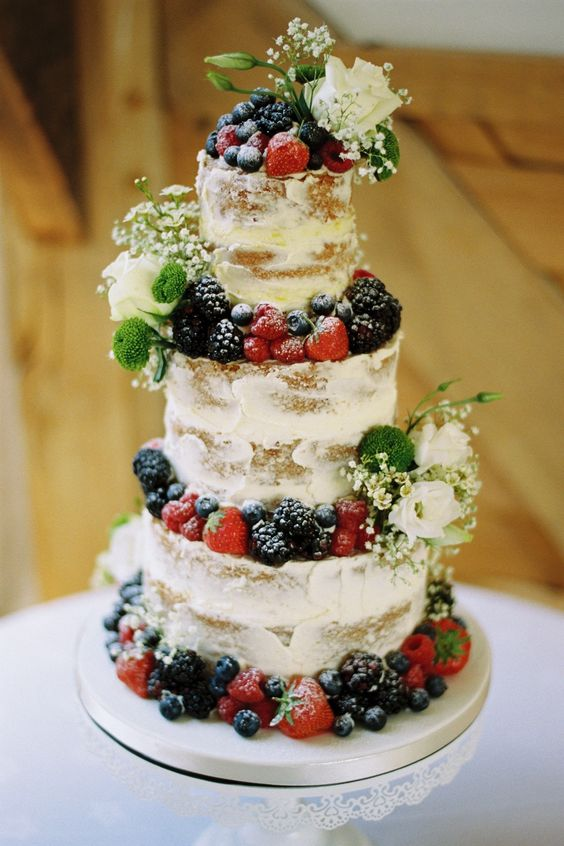 semi naked wedding cake with summer flowers and fresh berries