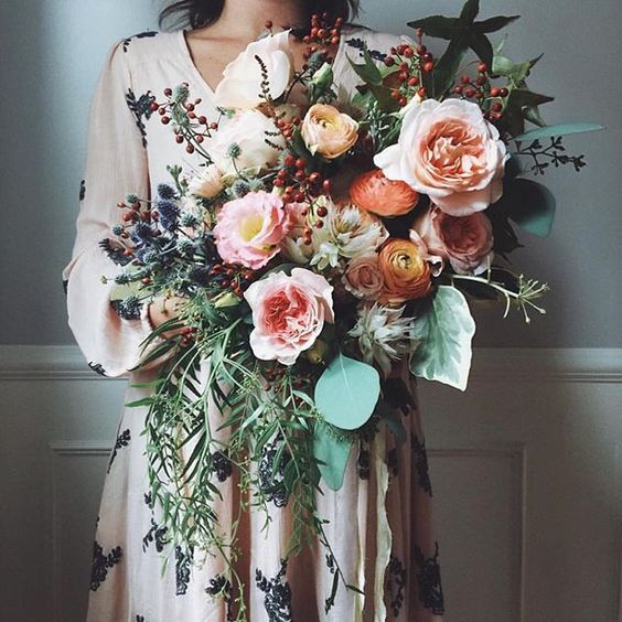 stunning peach-toned wedding bouquet with much greenery