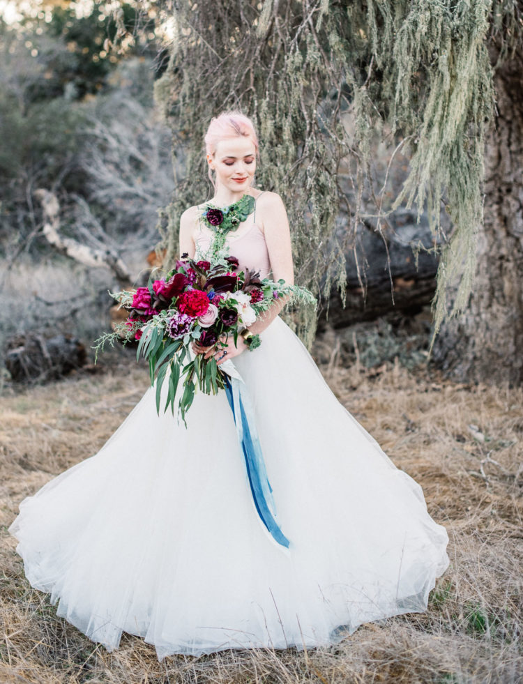 The bridal look was pretty simple, with a blush top and a white tulle skirt, though her pink hair and living jewelry added a twist