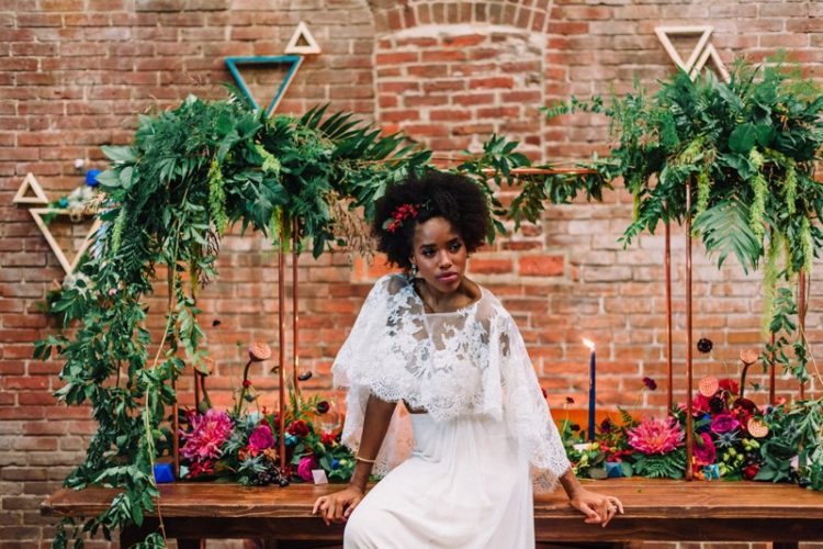 The bride was wearing a separate with a plain skirt and a lace capelet, chic and unusual