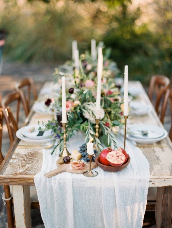The tablescape was a Mediterranean one with gold candle sticks, olive branches and lots of fruit