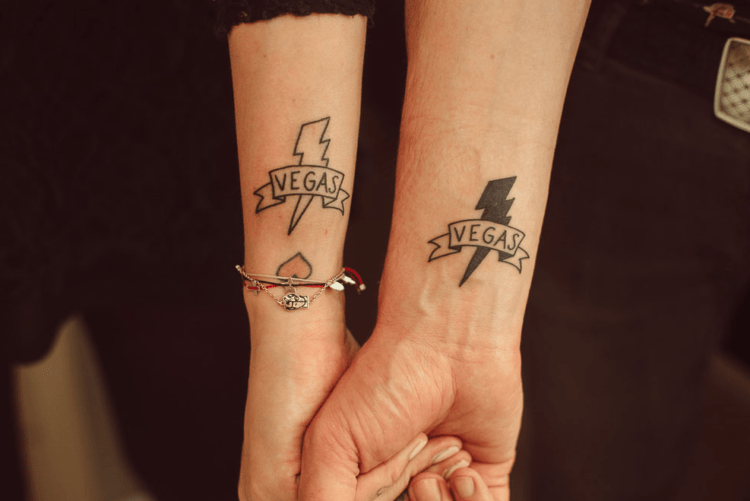Wedding couple tattoos are very actual and trendy now, and the guys made Vegas ones