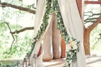 10 ceremony spot decorated with curtains and eucalyptus garland and neutral florals