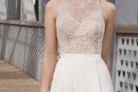 10 lace halter neckline wedding dress with a plain skirt and a thigh-high slit