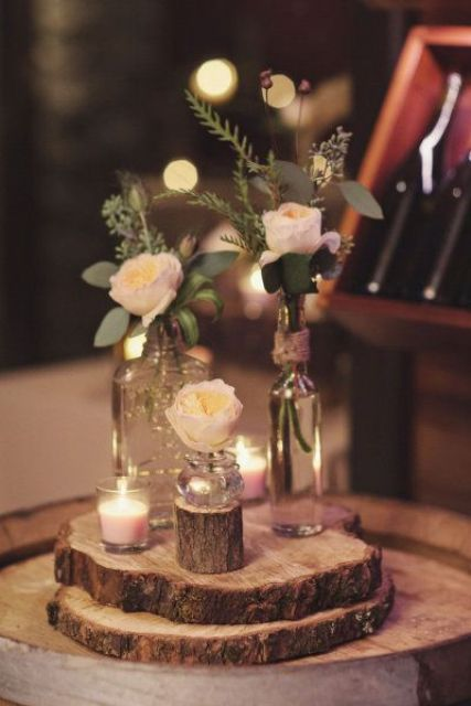 wood slices with bottles with flowers and candles