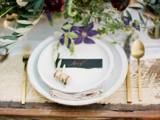 Gold tableware and wine corks as place card holders are a great idea for a vineyard wedding