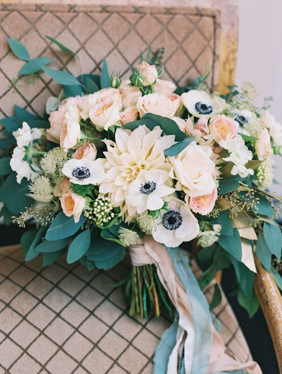 anemone and dahlia wedding bouquet with leaves