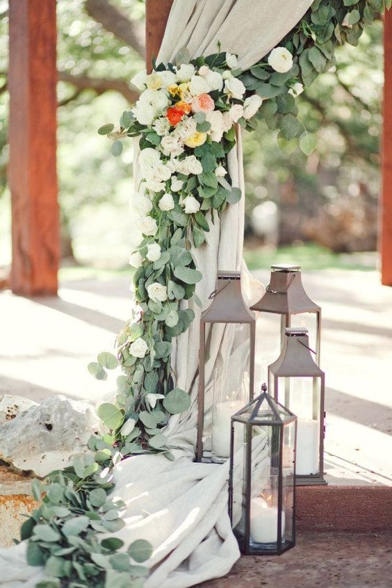 ceremony chuppah decor with eucalyptus and various florals