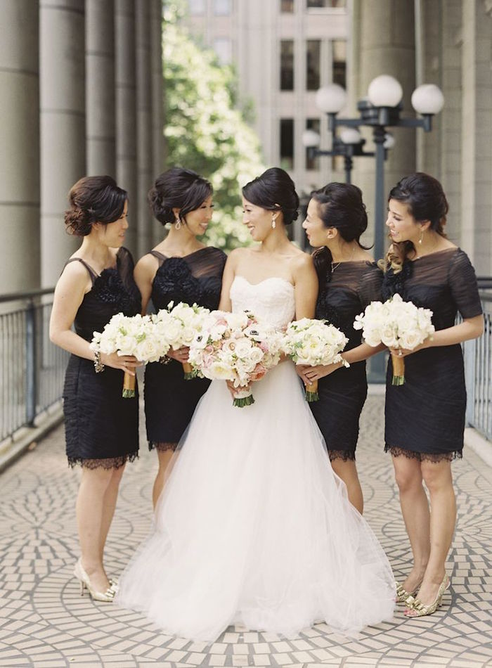 chic strapless wedding dress and short black bridesmaids' dresses