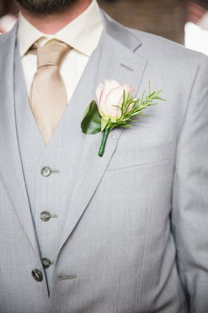 dove grey groom's suit looks great with a beige tie and a cream shirt