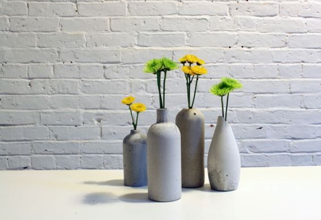 modern rough concrete vases with bold florals
