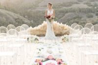 11 pampas altar, lucite chairs and a flower covered aisle for a boho ceremony