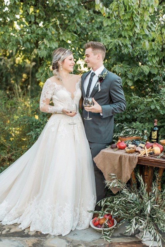 The bride was wearing an illusion plunging neckline wedding dress with long sleeves