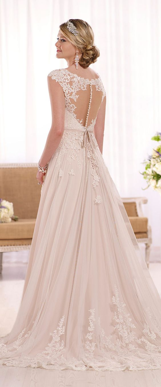 Picture Of blush wedding gown with an illusion back and buttons as ...