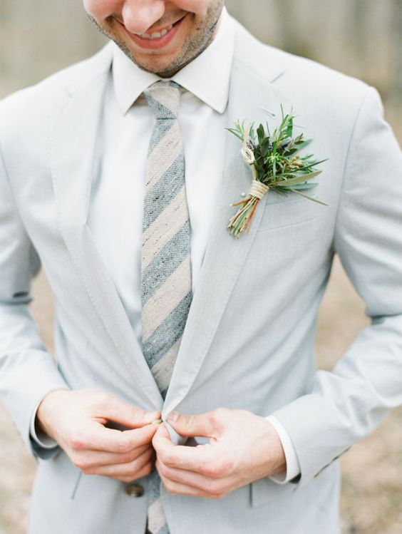 dove grey groom's suit with a striped tie