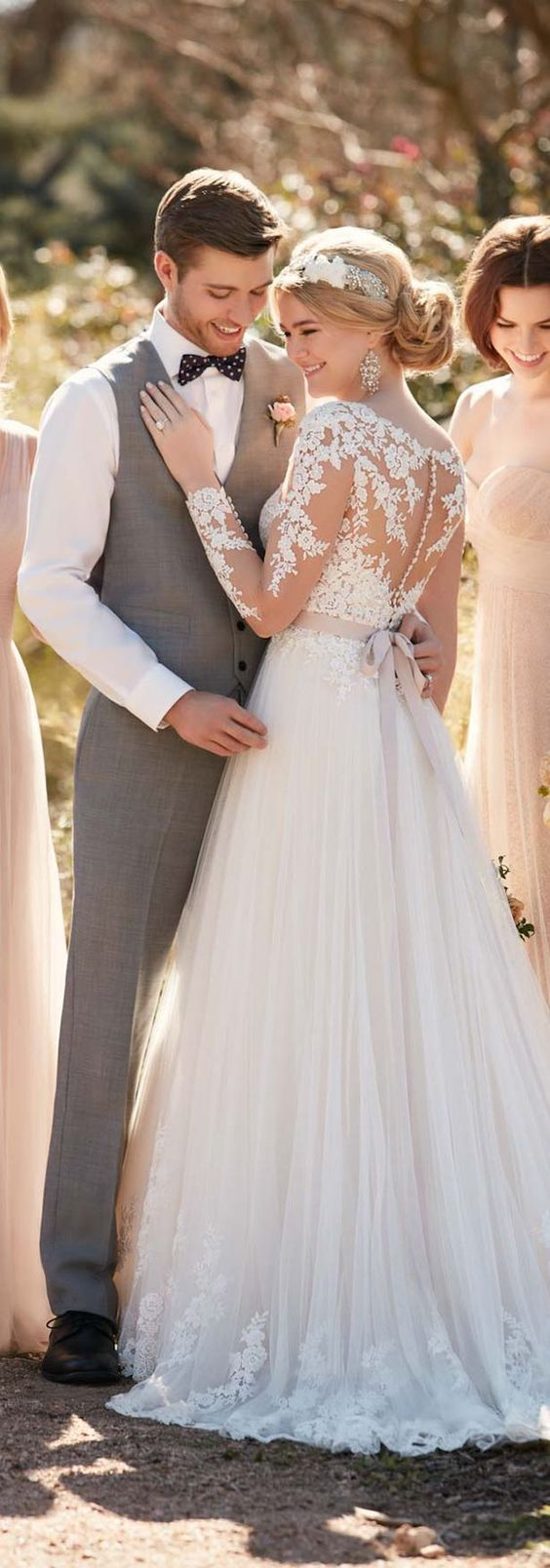 lace ball gown with a lace illusion back and a row of tiny buttons