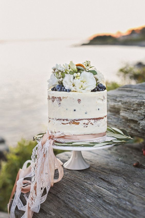 single tier wedding cake with flowers and berries for a summer wedding