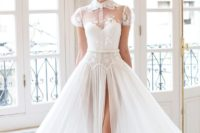 14 white ball gown with short sleeves, an illusion neckline and a high slit