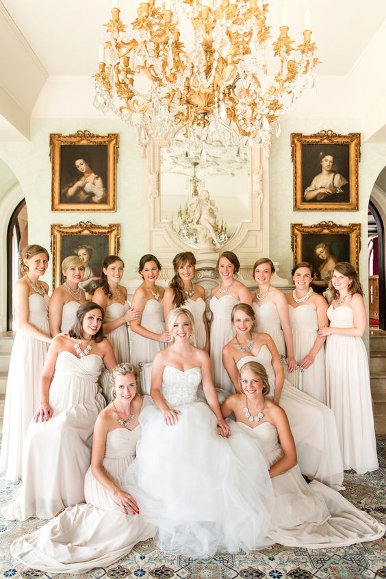 all-white bridal party in strapless gowns looks luxurious
