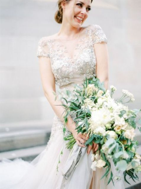 intricate lace wedding dress with cap sleeves