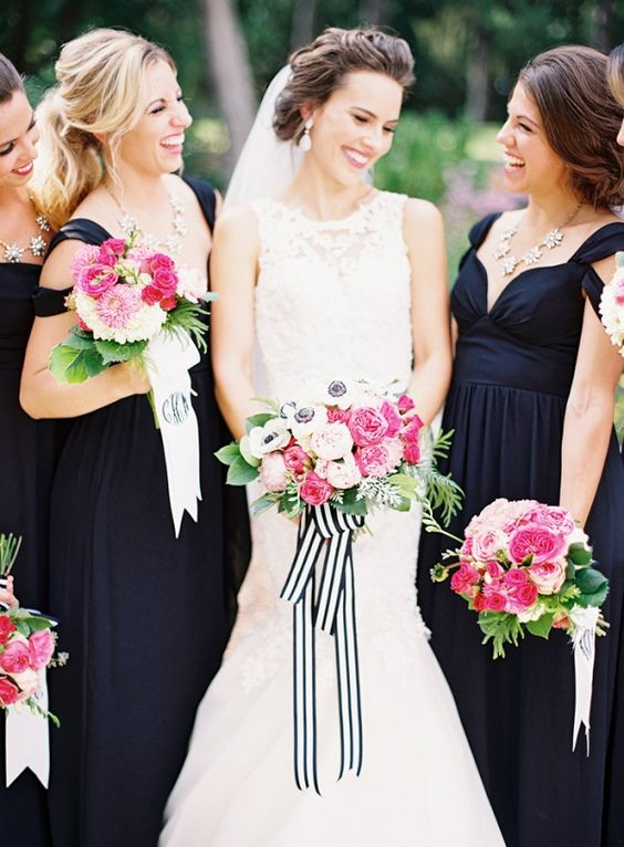 chic black maxi dresses for the bridesmaids and the bride in a sleeveless lace wedding dress
