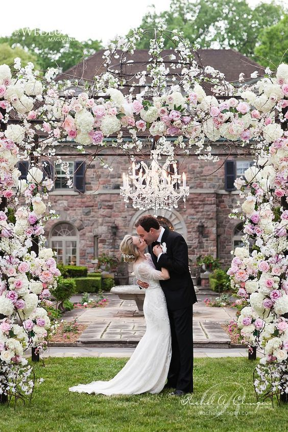 chic spring blush and white floral wedding arch looks dreamy