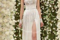 16 sparkling strapless wedding dress with a side slit