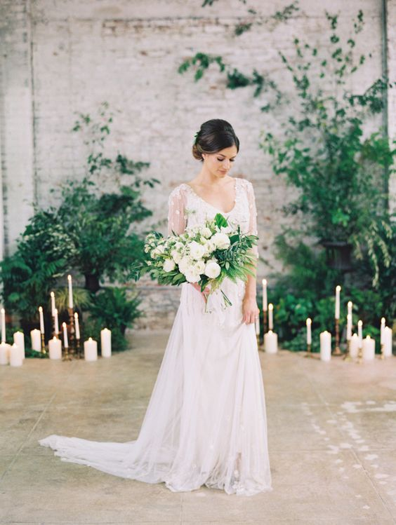 ethereal ivory wedding dress with a small train is a less formal option