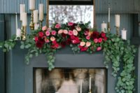 17 faux fireplace decorated with candles, eucalyptus garlands and bold florals