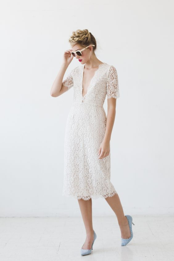 white lace midi dress with short sleeves and a plunging neckline