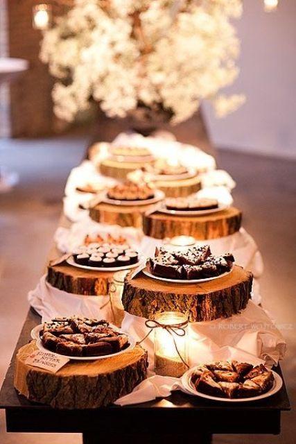 dessert bar with food displayed on wood slices