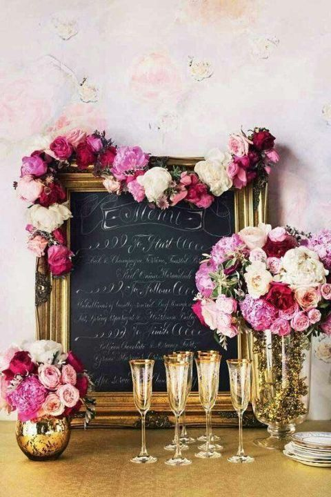 metallic gold frame and mercury vases with lush florals