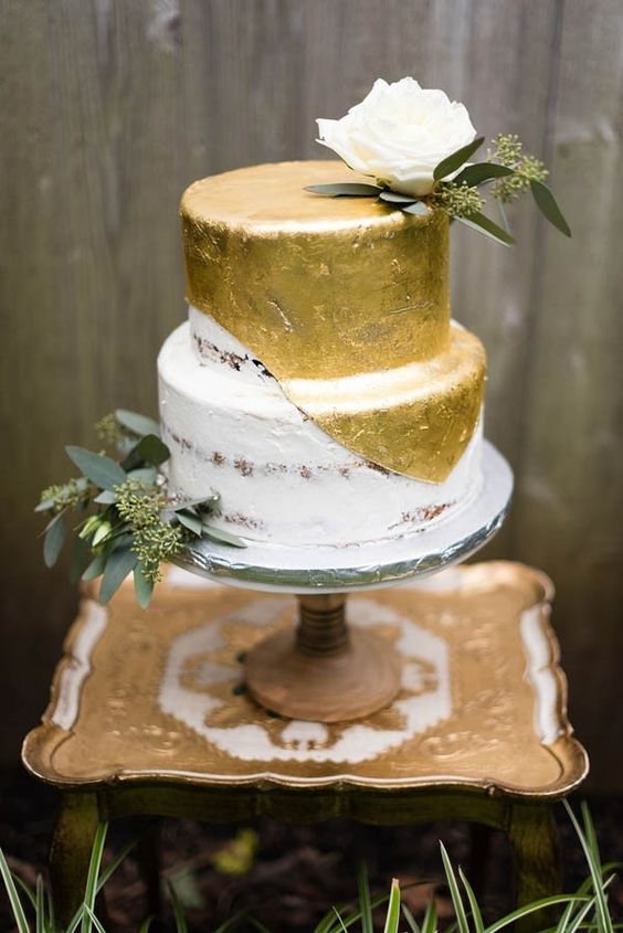 metallic gold half naked wedding cake with eucalyptus and a rose