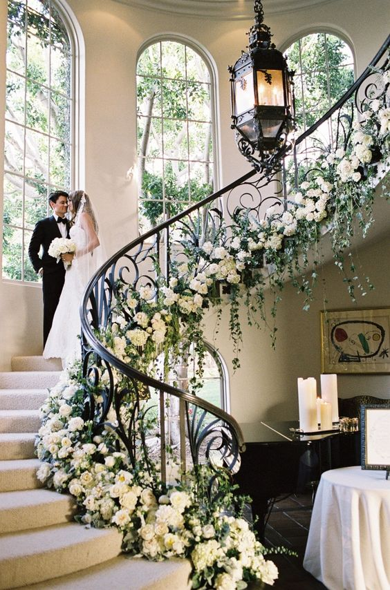refined white flower decor for the staircase looks stunning