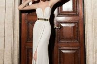 18 textural sheath wedding dress with a plunging neckline, spaghetti straps and a metallic belt