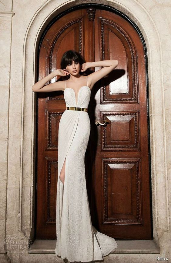 textural sheath wedding dress with a plunging neckline, spaghetti straps and a metallic belt