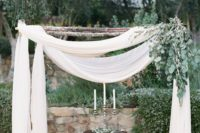 18 wedding arch with light fabrics and eucalyptus