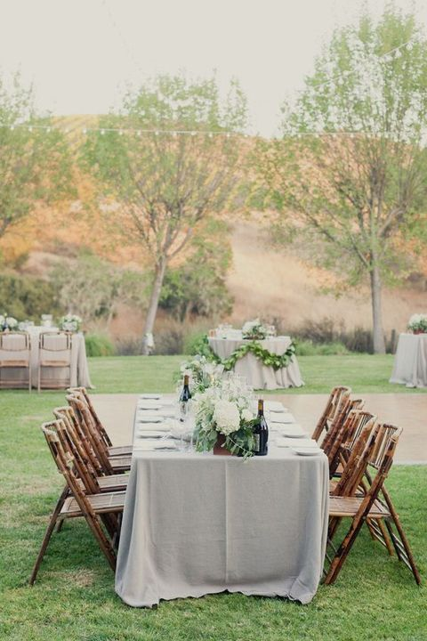 dove grey wedding tablecloth looks perfect with white florals