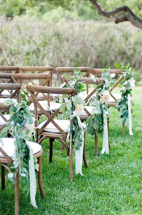 eucalyptus, flowers and ribbon for aisle chair decor