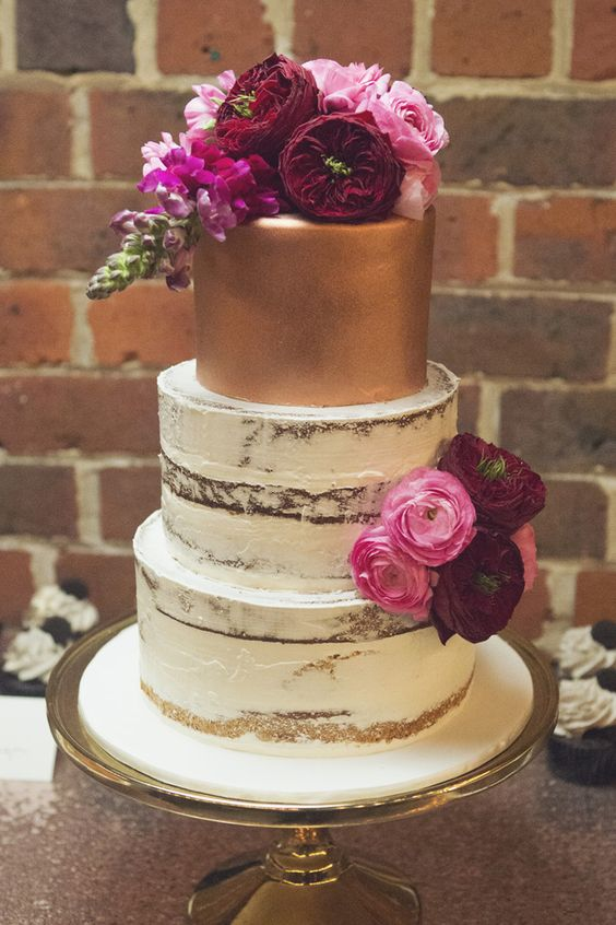 gold semi naked wedding cake with pink and burgundy flowers